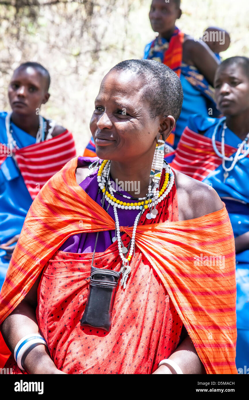 Proud Maasai woman with cell phone posing for camera in Africa;East Africa;Tanzania;young and older women and Maasai - Stock Image
