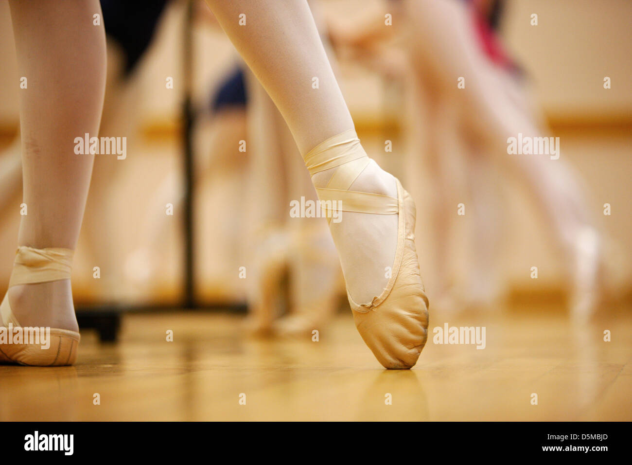 pointed toe in ballet slippers at a ballet school in the uk - Stock Image