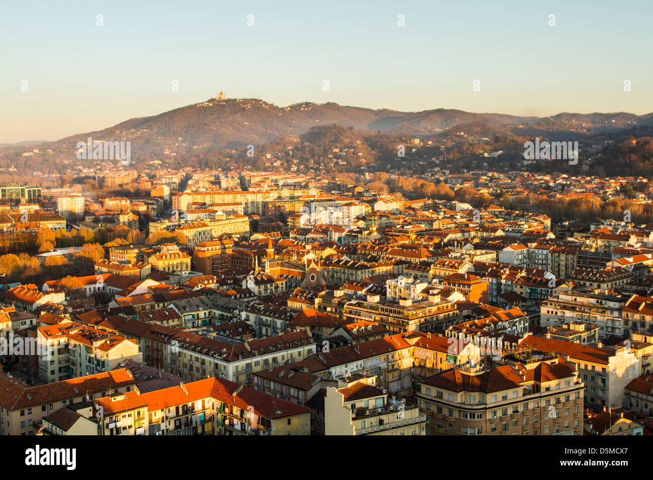 View of the city of Turin from the top of Mole Antonelliana, with the Hill of Superga in the background. - Stock Image