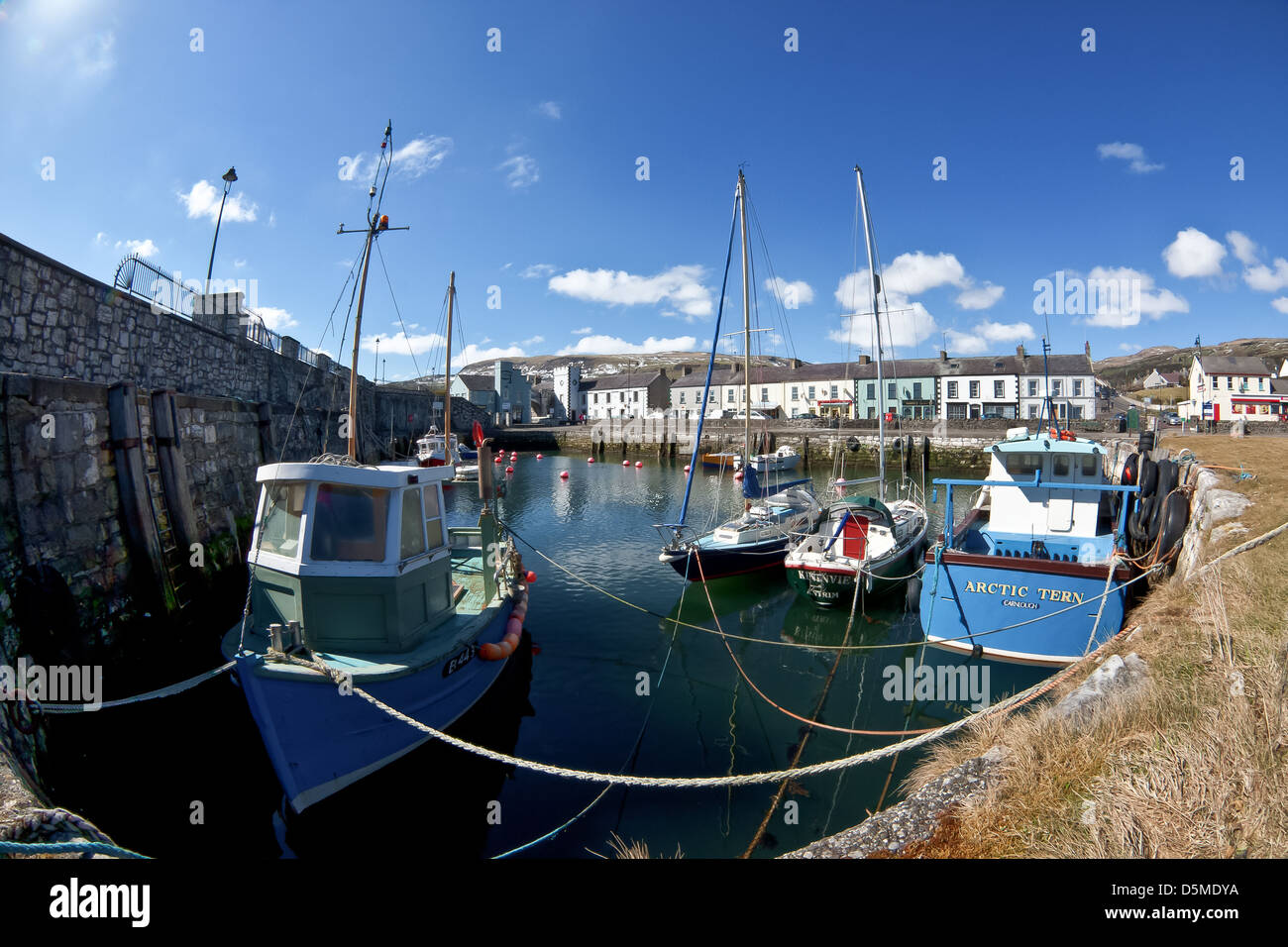 Carnlough Harbour and fishing village in the Glens of Antrim N.Ireland. - Stock Image