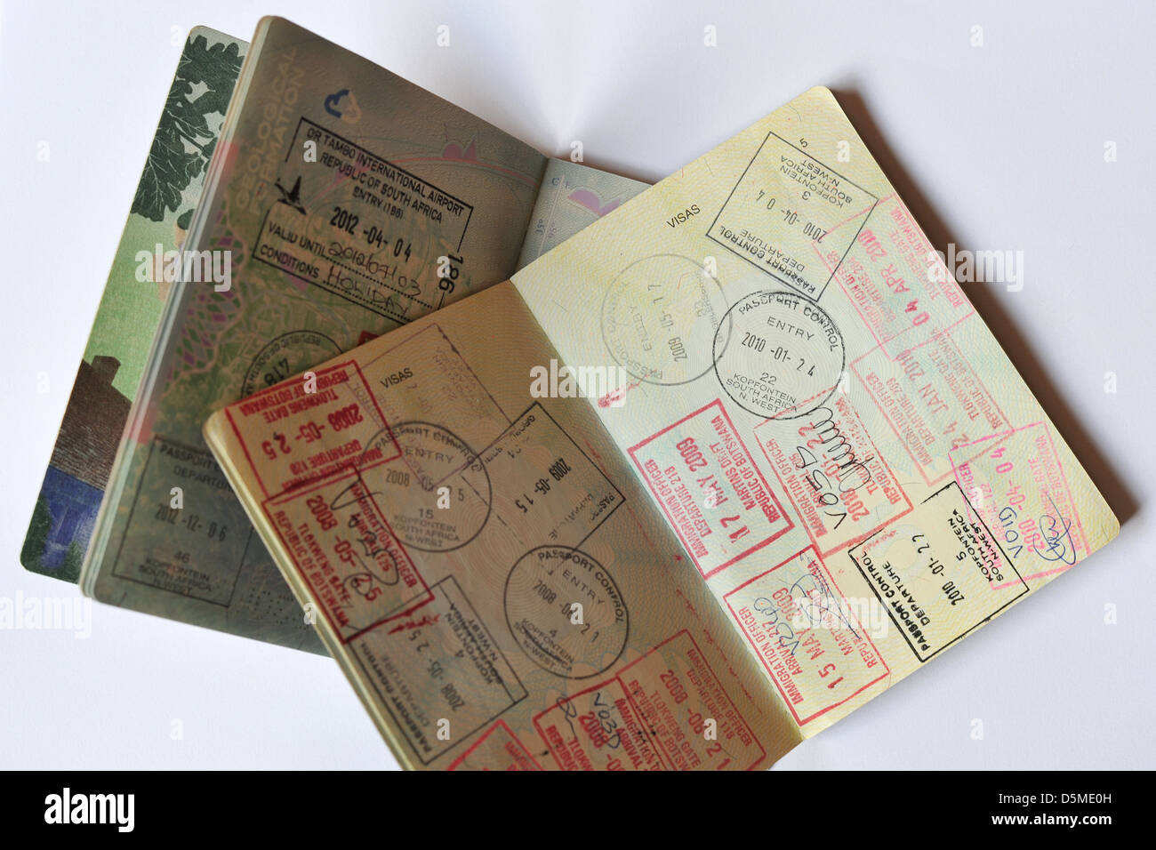 Two Passports with fully used Visa pages stamped full of Visas. - Stock Image