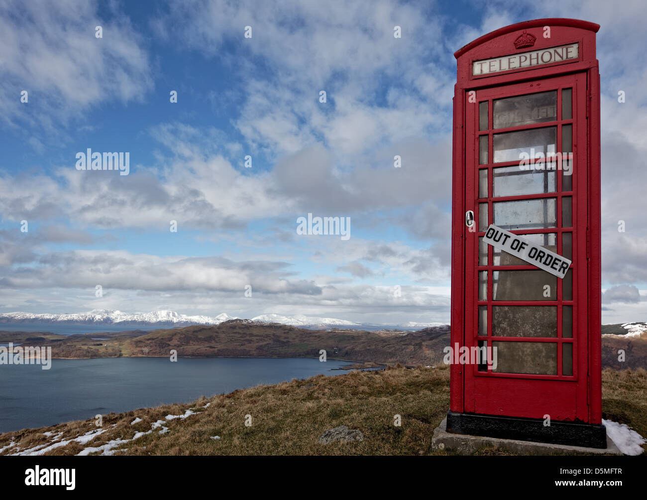 A disused red telephone box relocated on a Triangulation point in Arduaine, Argyle and Bute, Scotland, UK - Stock Image