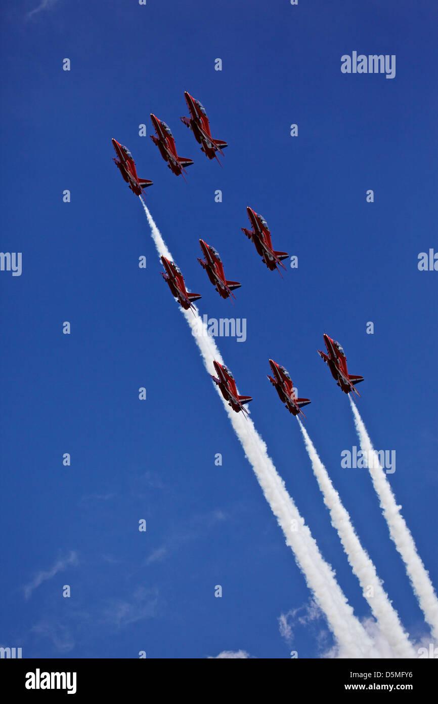 Red Arrows RAF aerobatics display team in formation over Lyme Regis, Dorset, UK - Stock Image