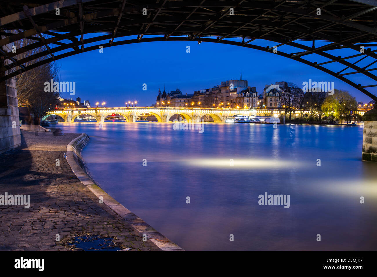 Pont Neuf viewed from below the arches of Pont des Arts. - Stock Image
