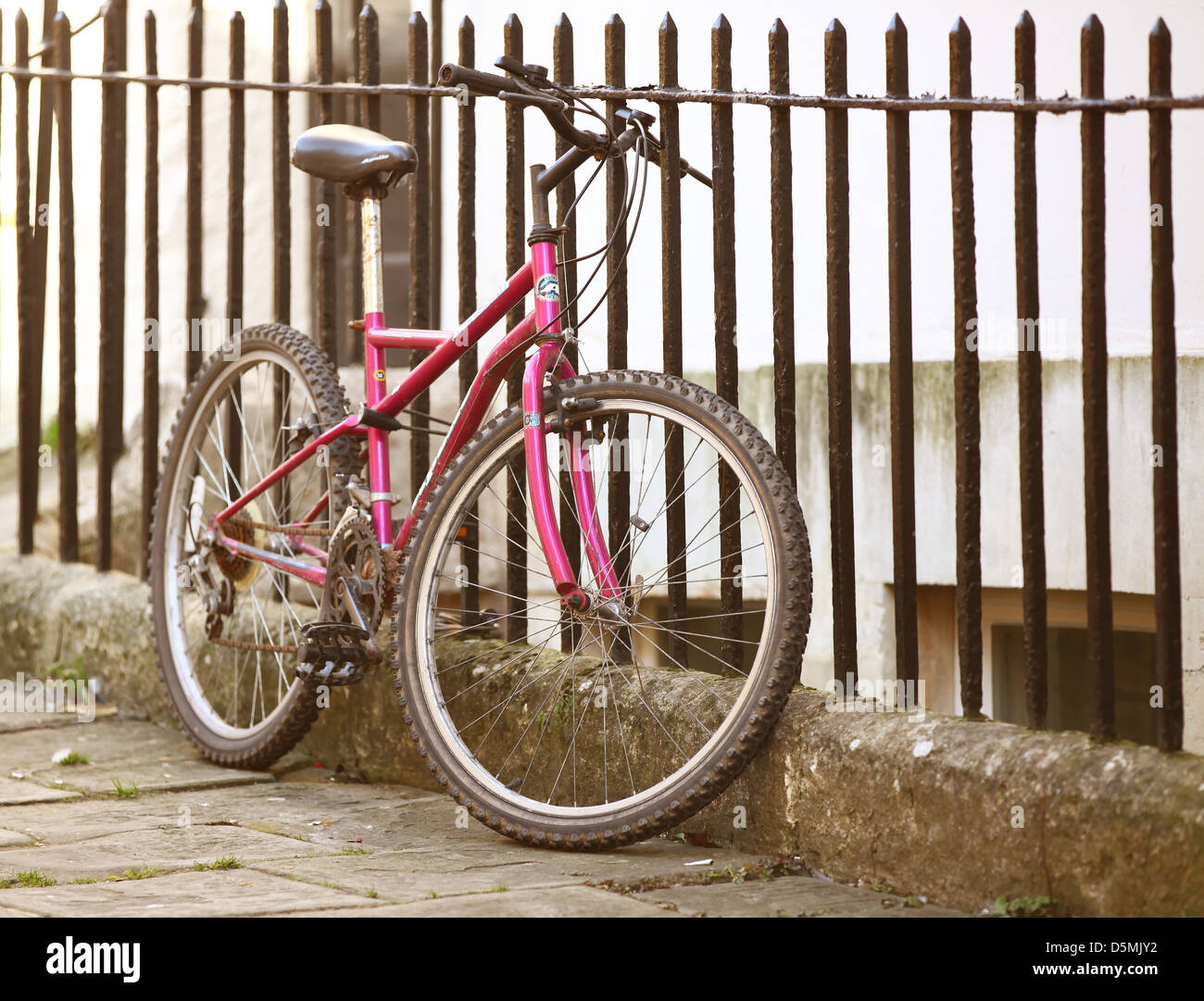Parked and securely lock bicycle in the centre of Bath. April 2013 - Stock Image