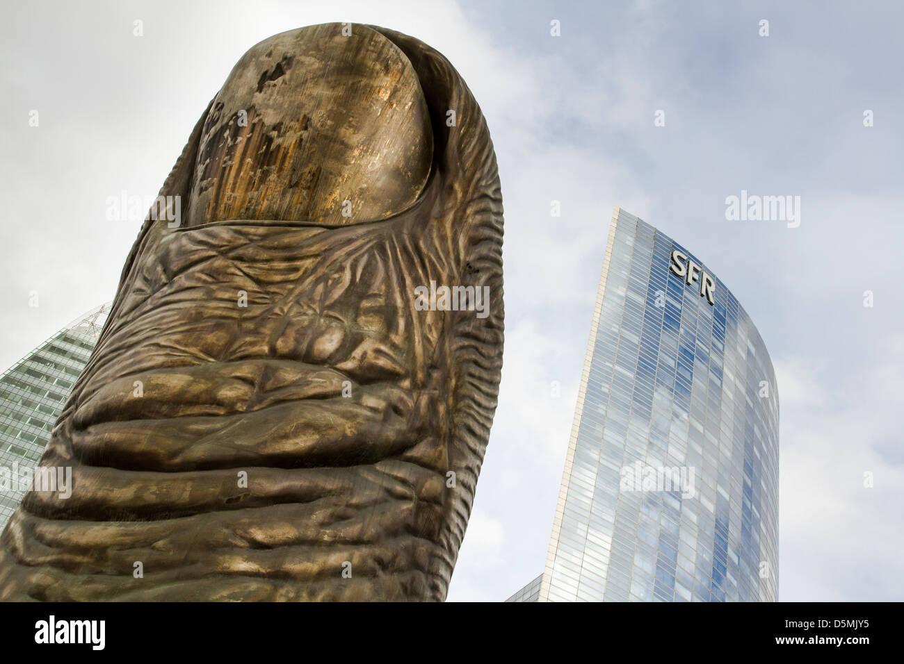 'Le Pouce' sculpture, by Cesar Baldaccini, in La Defense, a major corporate park in Paris. - Stock Image