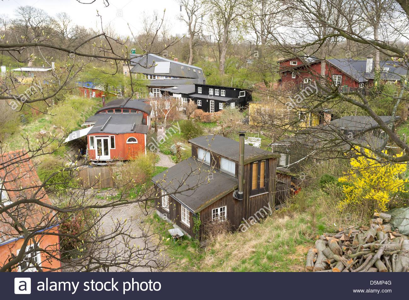 Buildings in Freetown Christiania, Copenhagen, Region Hovedstaden, Denmark - Stock Image