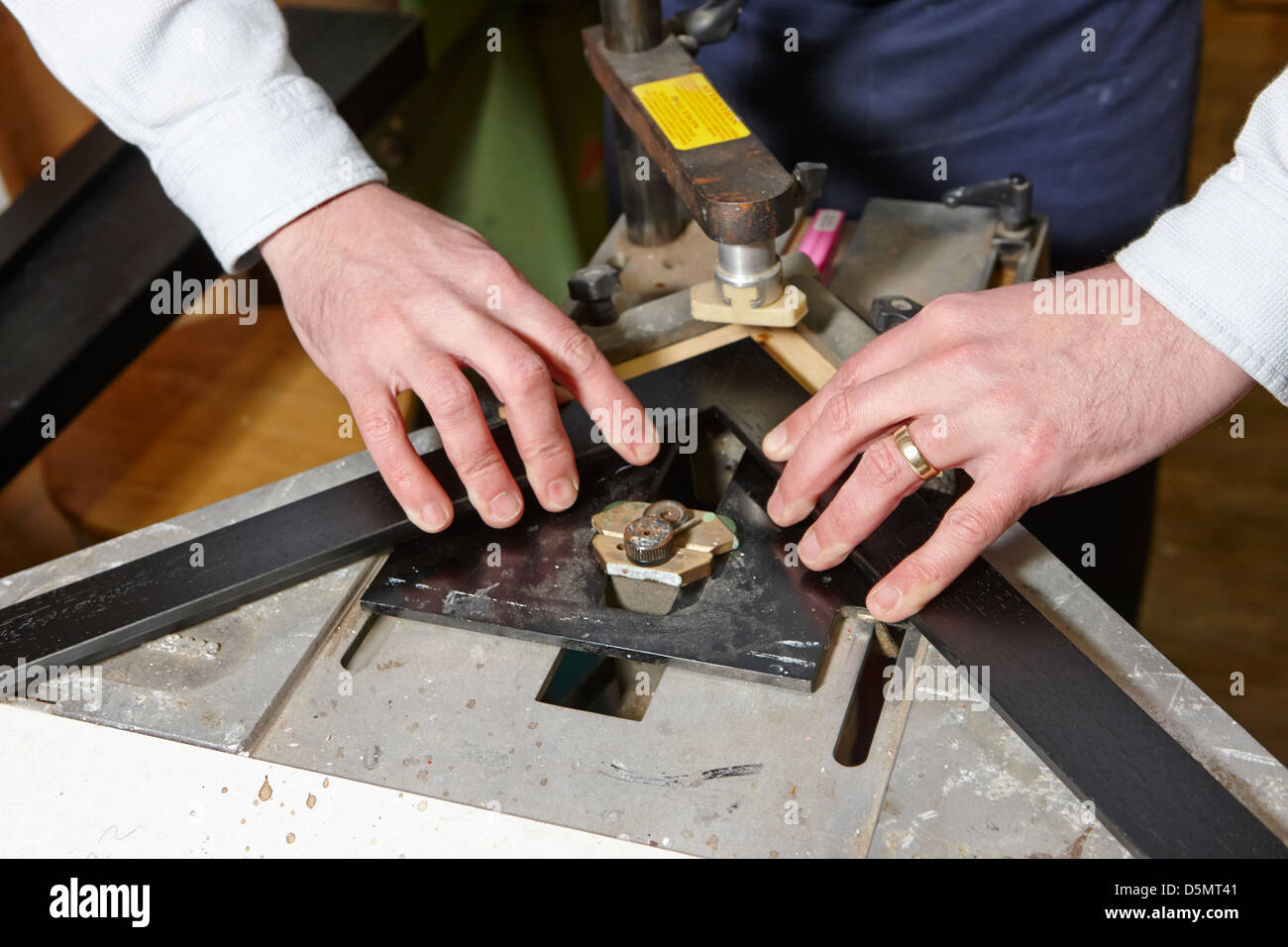 Framer Using A V Nailer Picture Frame Joiner In A Framing Workshop