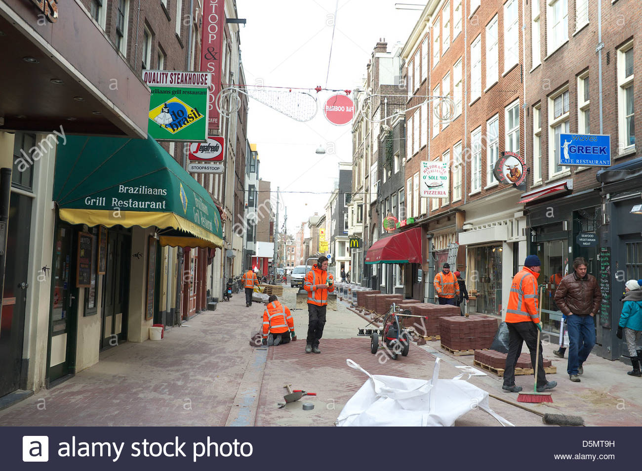 Pedestrian precinct block paving construction works, in Amsterdam, the Netherlands. Stock Photo