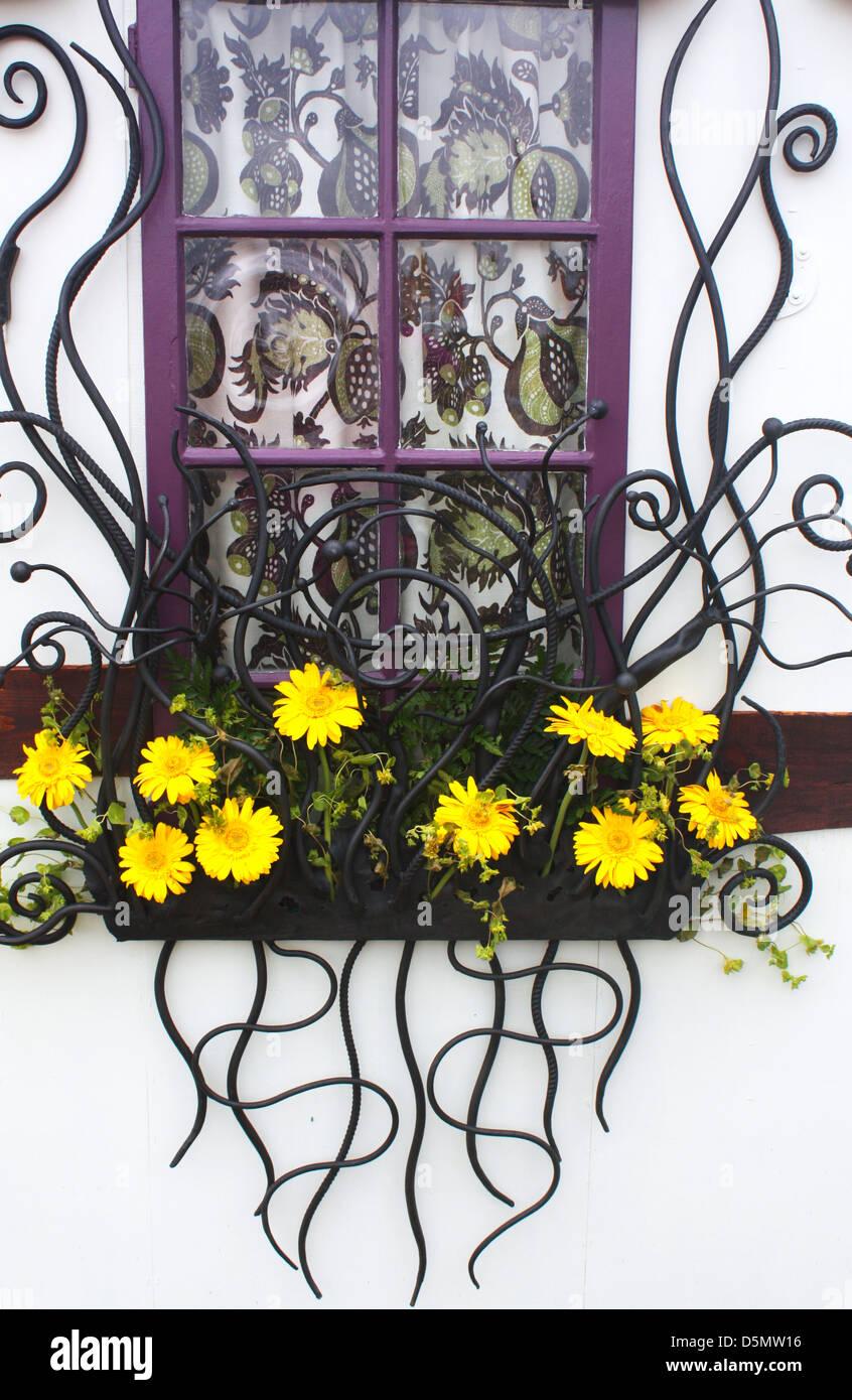 Decorative window with flowers Stock Photo