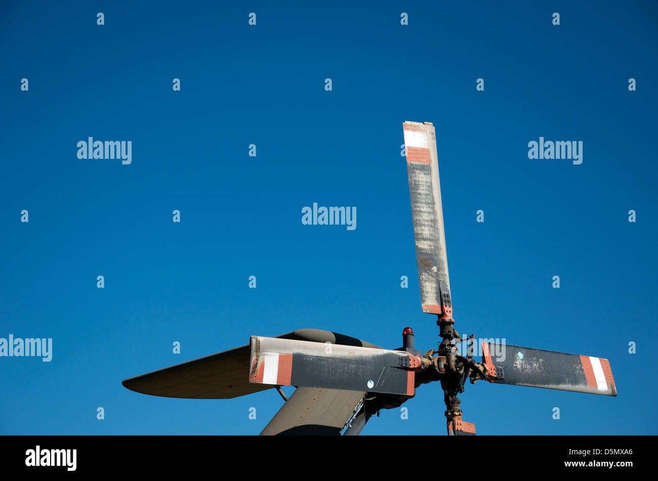 Tail rotor on a military helicopter against blue skies. - Stock Image