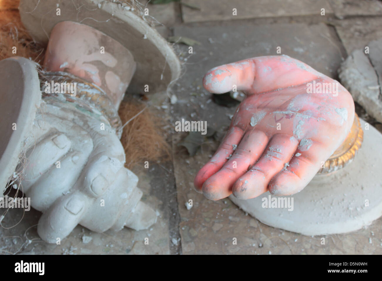The incomplete hands of the idol of Lord Ganesh lie in a craftsman home in the Gulbai Tekra area of Ahmedabad, Gujarat, - Stock Image