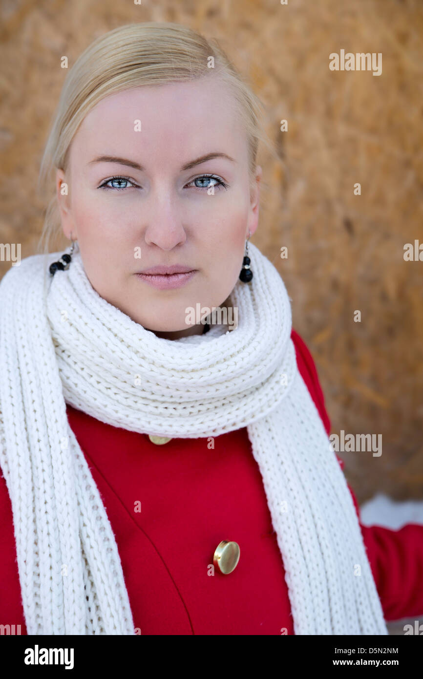 Zoomed young woman face watch focused on camera - Stock Image