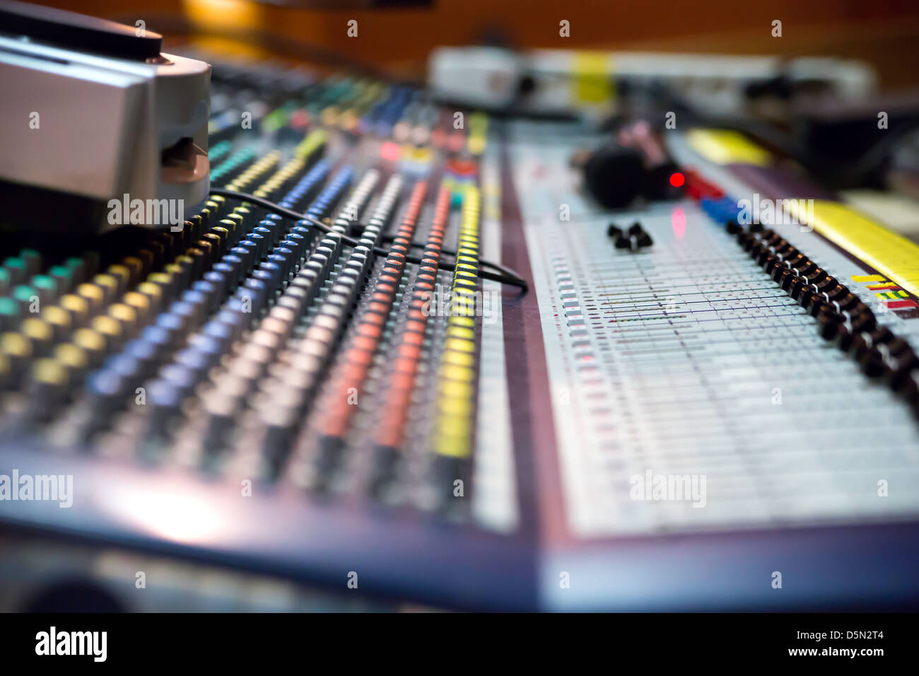Zoomed view on sound mixer with regulation buttons - Stock Image
