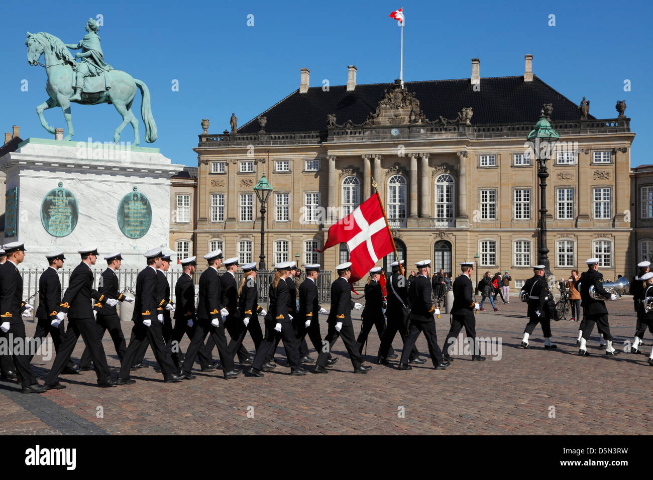 Copenhagen, Denmark. April 4th 2013. Cadets from the Royal Danish Naval Academy accompanied by the playing and singing - Stock Image