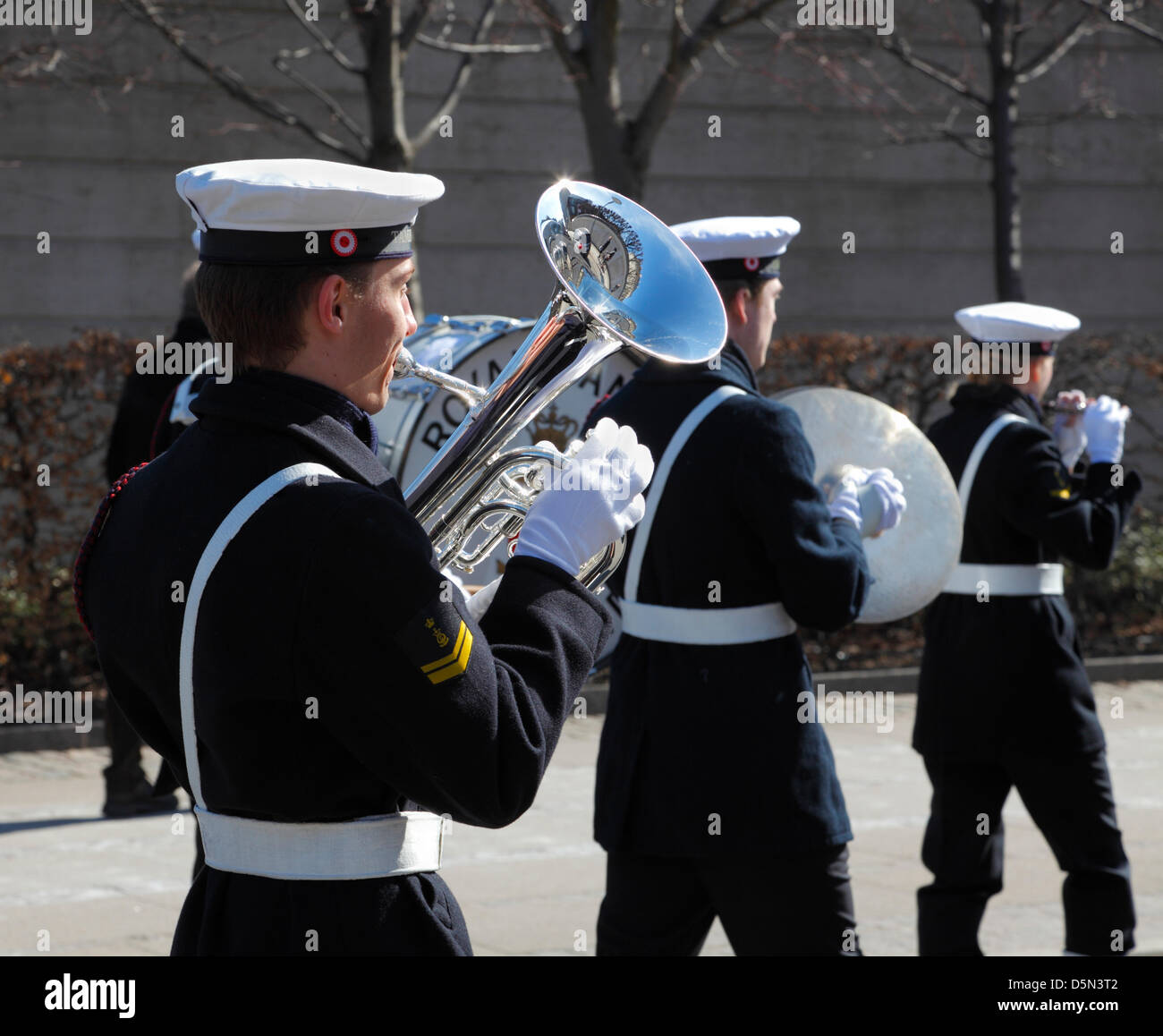 Copenhagen, Denmark. April 4th 2013. The playing and singing Royal Danish Navy Band accompanying the cadets from - Stock Image