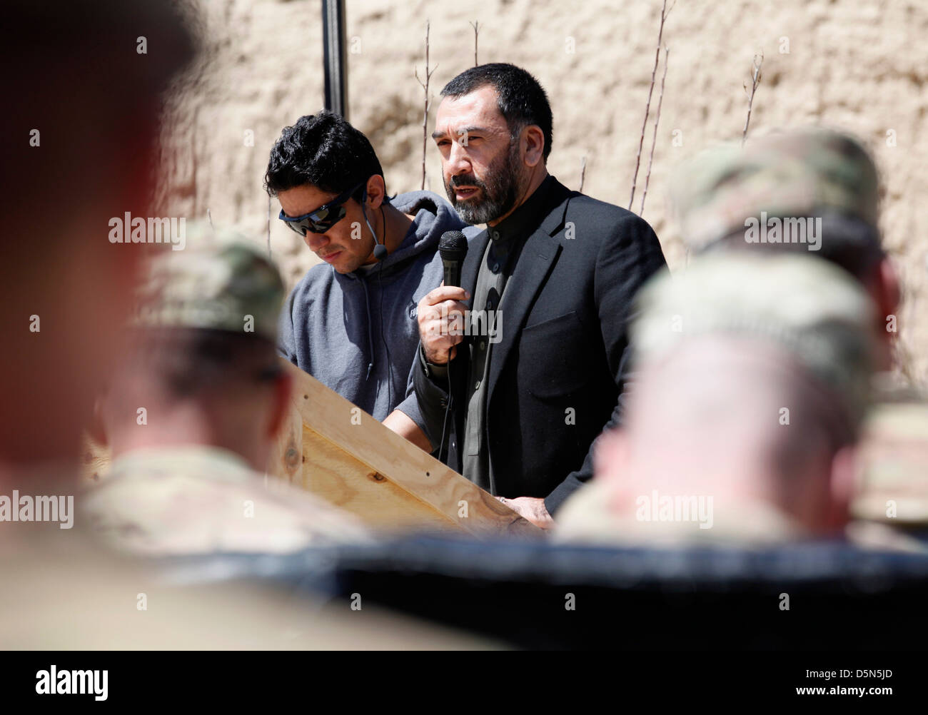 Paktya Provincial Governor Juma Khan Hamdard speaks at the closing ceremony of Provincial Reconstruction Team Gardez - Stock Image