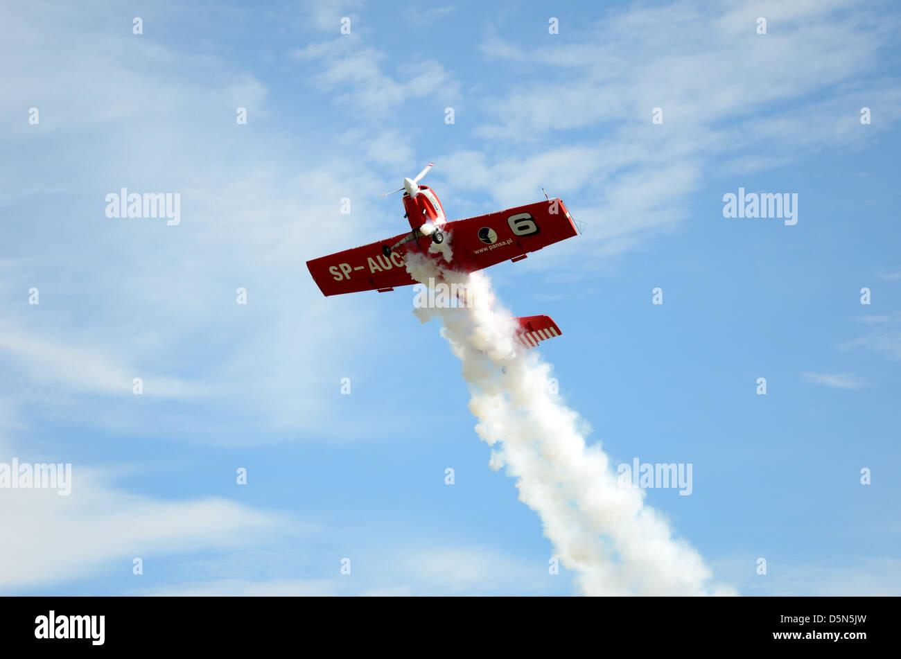 Pilot Tadeusz Kolaszewski performs acrobatic show in plane Zlin-50 LS on August 25, 2012 in Szymanow airport in - Stock Image