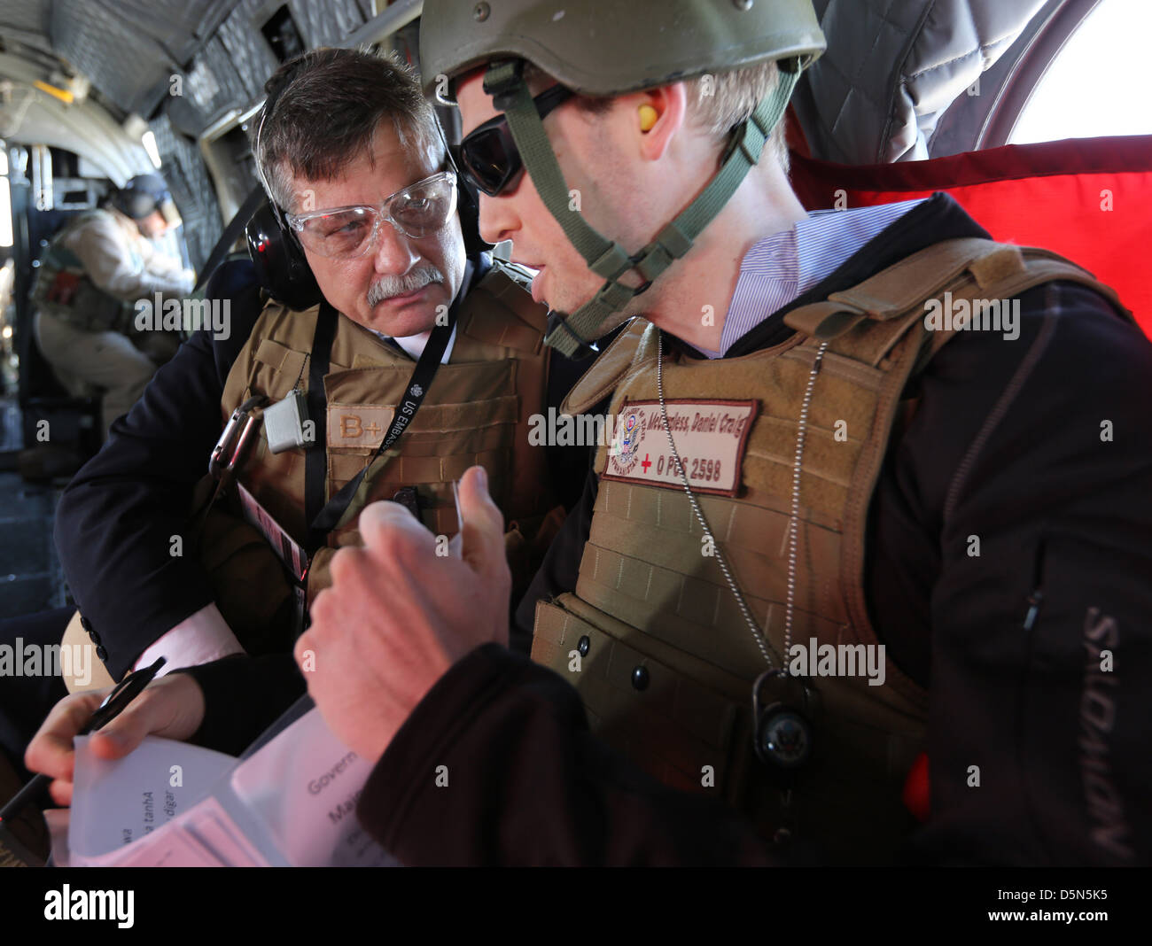 US Ambassador Stephen McFarland (left) flies by helicopter to the closing ceremony of Provincial Reconstruction - Stock Image