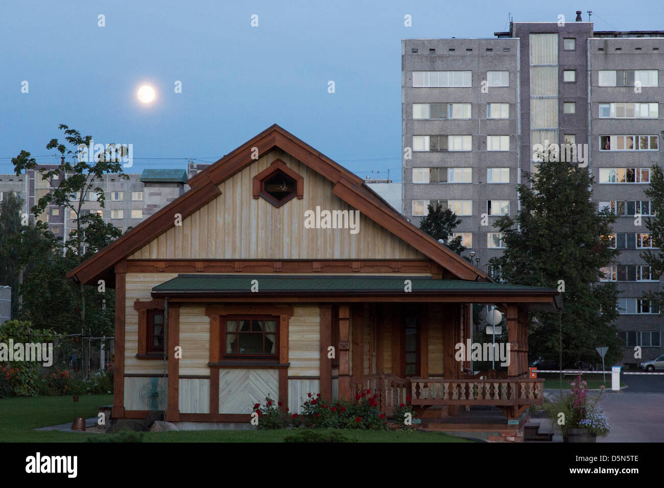 precast concrete blocks from soviet times in a suburb of Riga at moonlight behind a modern prefab - Stock Image
