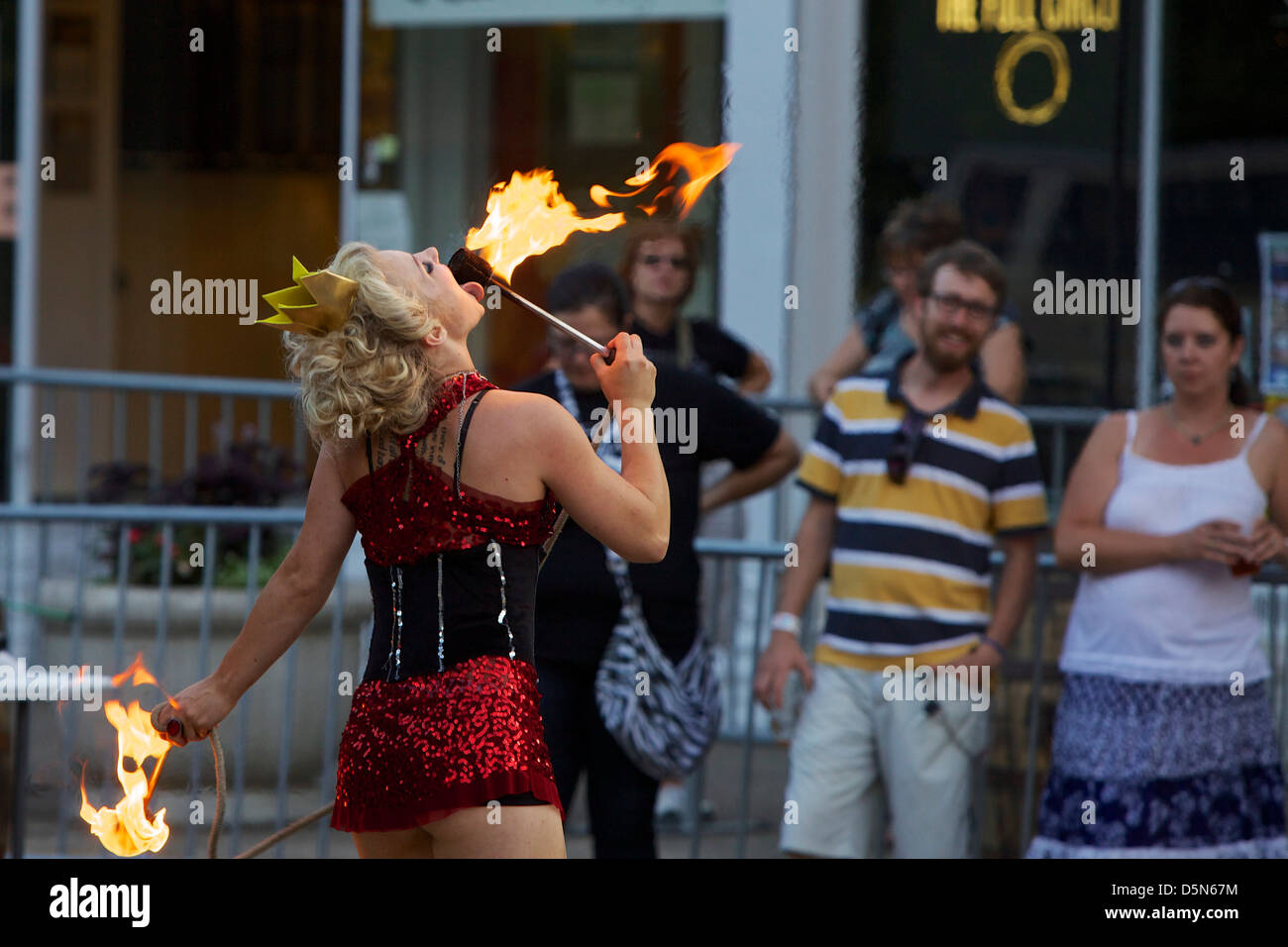 Fire eater performer at Hatter Days Street Party New Holland Brewing Co. - Stock Image
