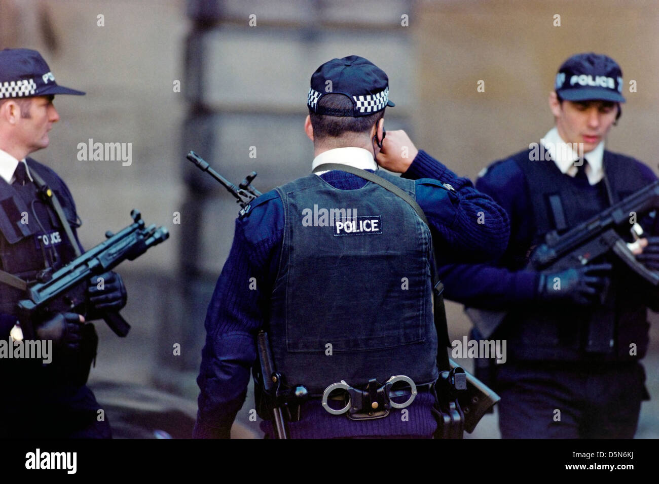 Armed police deployed outside the High Court in Edinburgh, Scotland. - Stock Image