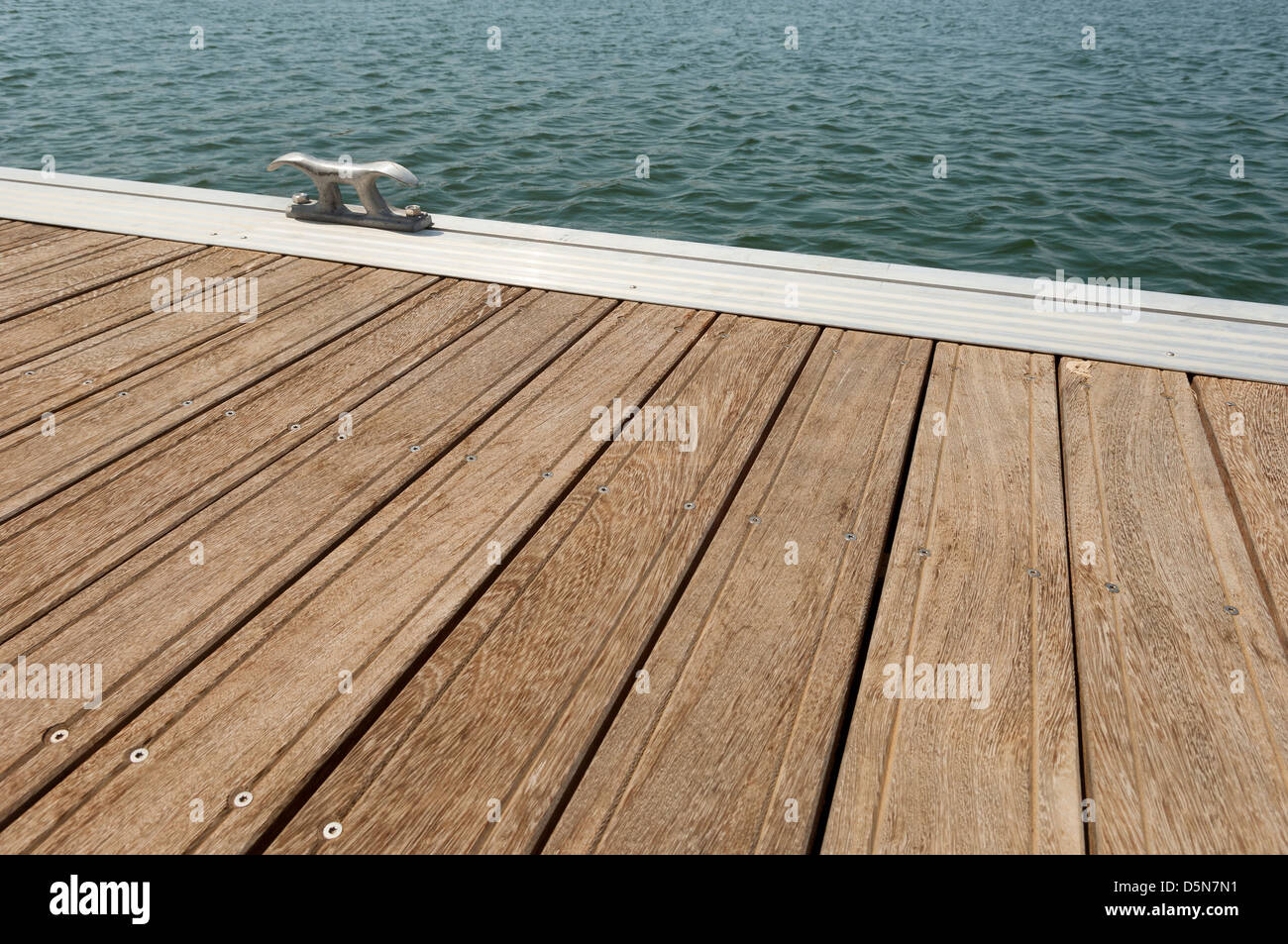 Detail of a wooden floating dock with mooring bitts - Stock Image