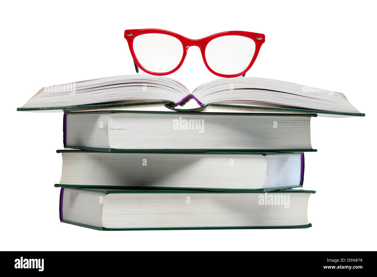 red glasses on open book, pile or stack of books isolated over white background - Stock Image