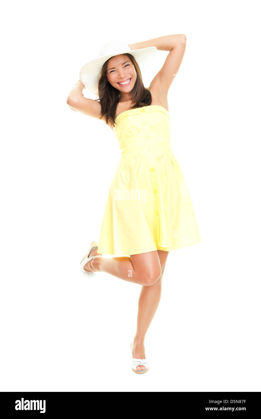 Portrait of beautiful fresh young mixed race woman in yellow sundress and summer hat isolated on white background - Stock Image
