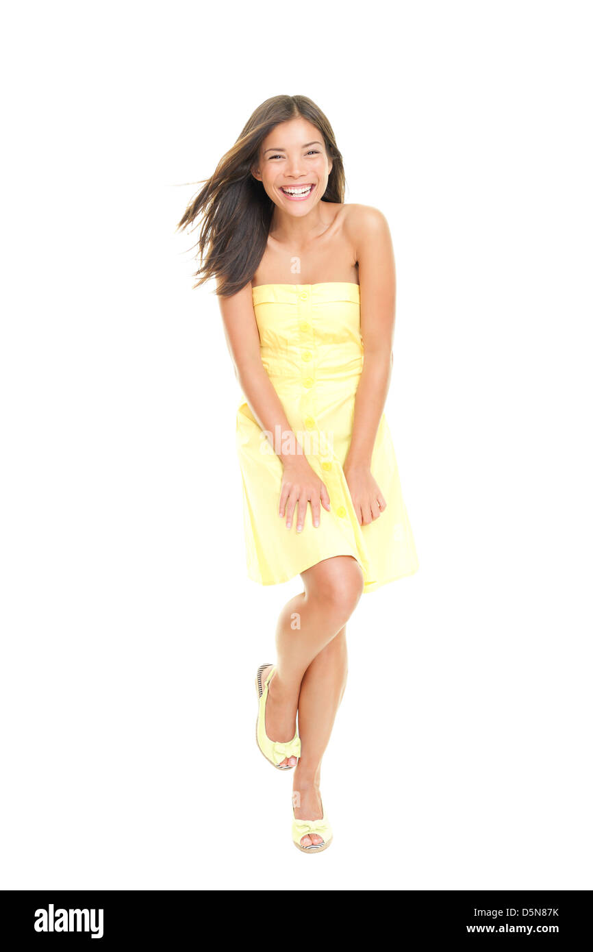 Portrait of beautiful fresh young mixed race Asian Caucasian woman in yellow sundress smiling isolated on white - Stock Image