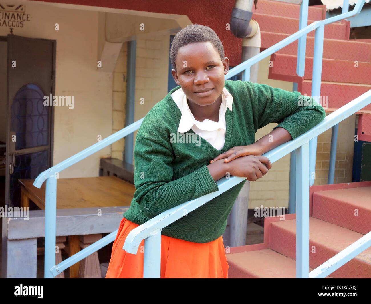 young teenage Maasia girls in Western school uniform posing for camera in Moshi;Tanzania;East Africa;Africa - Stock Image