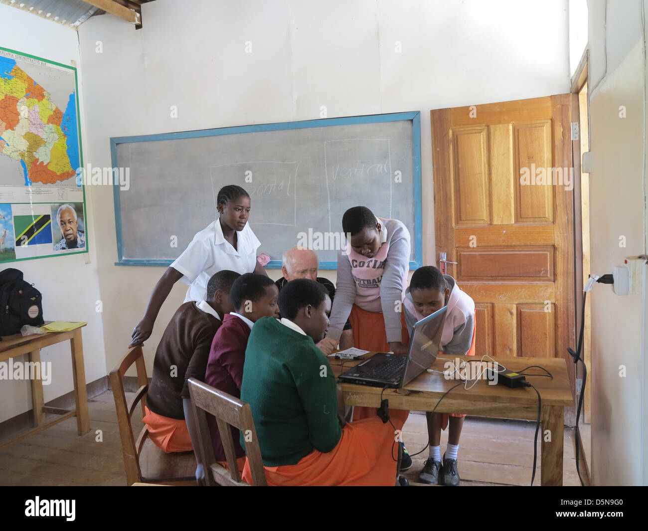 young African teenage girls in a school room leaning computer work  in Moshi;Tanzania;East Africa;Africa - Stock Image