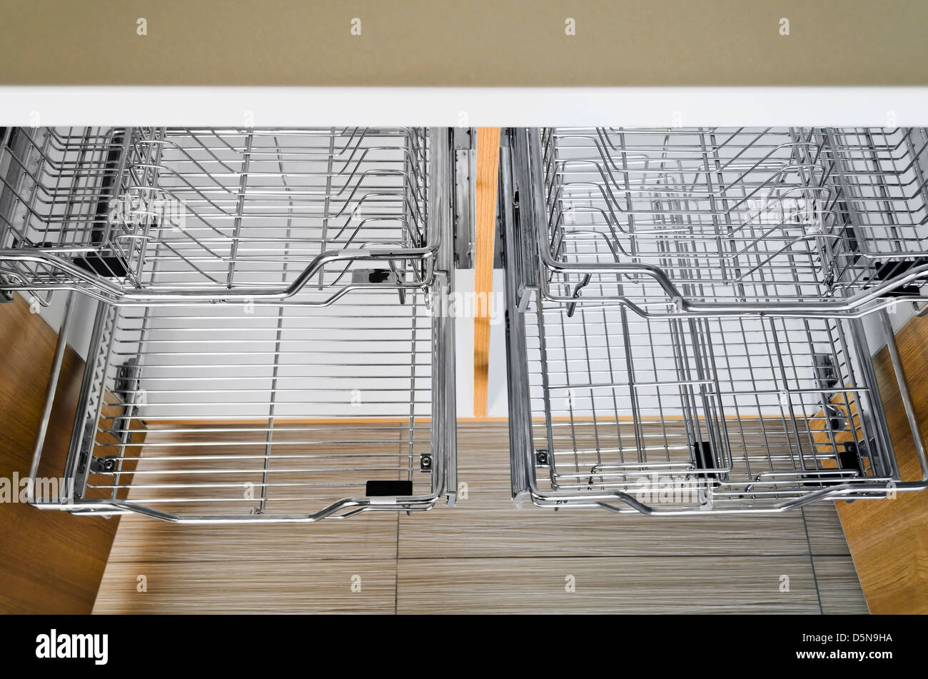 Open Kitchen Cabinet With Two Layers Of Stainless Dish Rack Stock Photo: 55172918