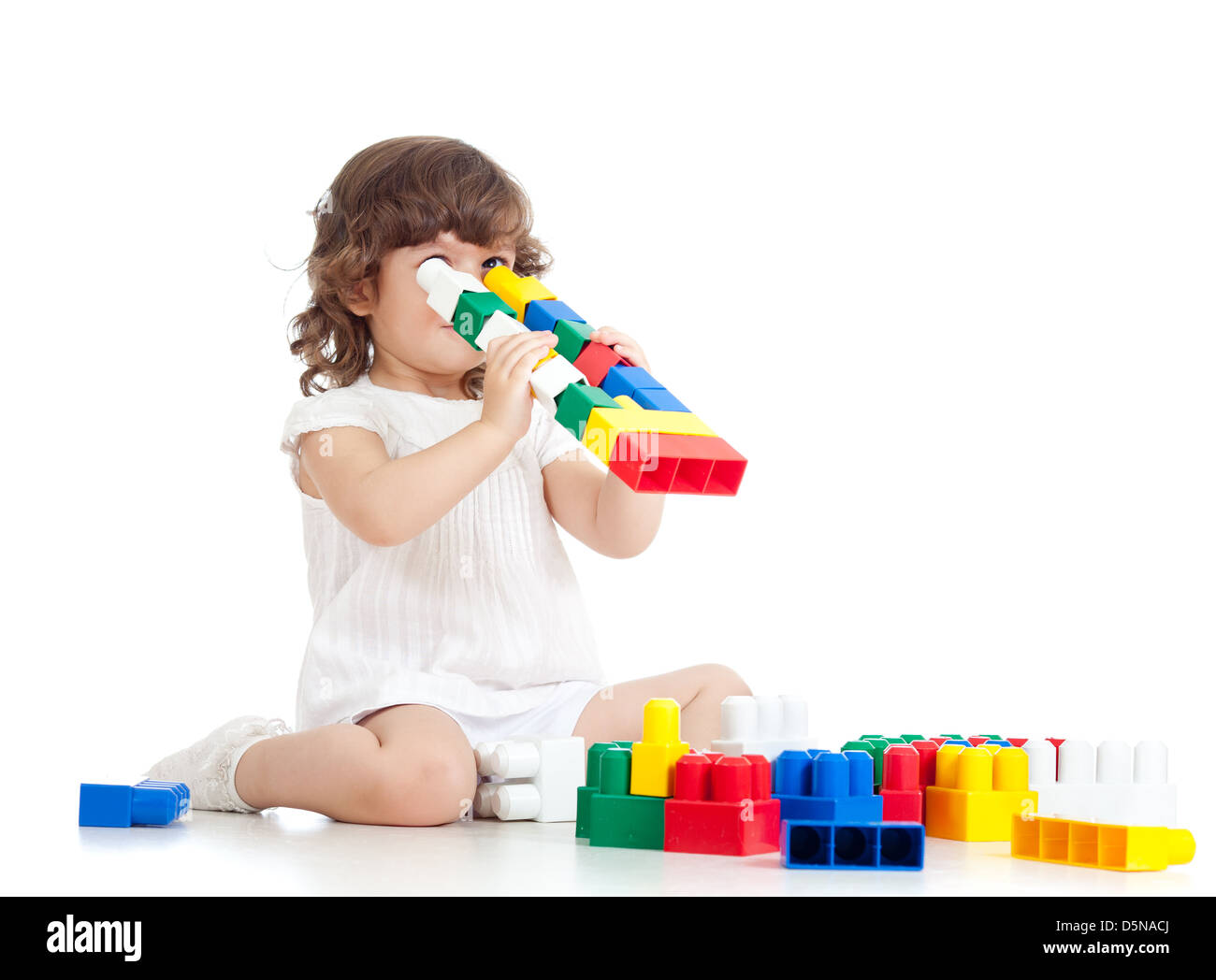 inventive kid with construction set toy over white background - Stock Image