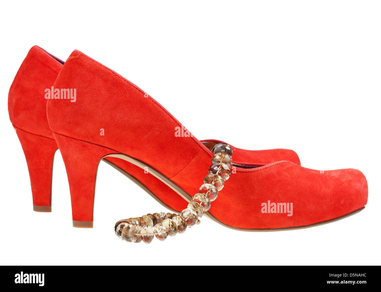red high heel pump shoes with necklace isolated on white background - Stock Image