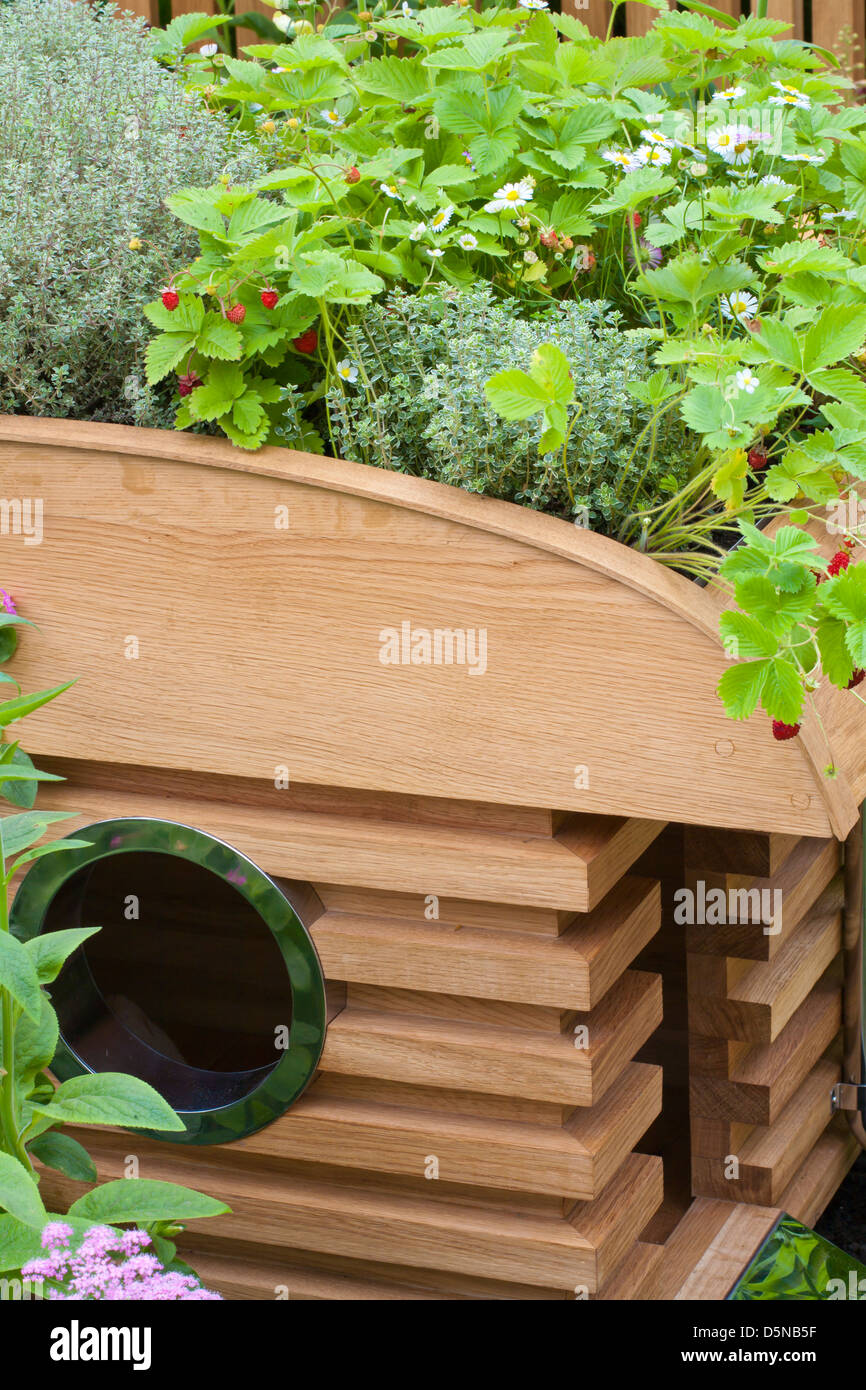 Raised Bed In Contemporary Garden Planted With Perennials