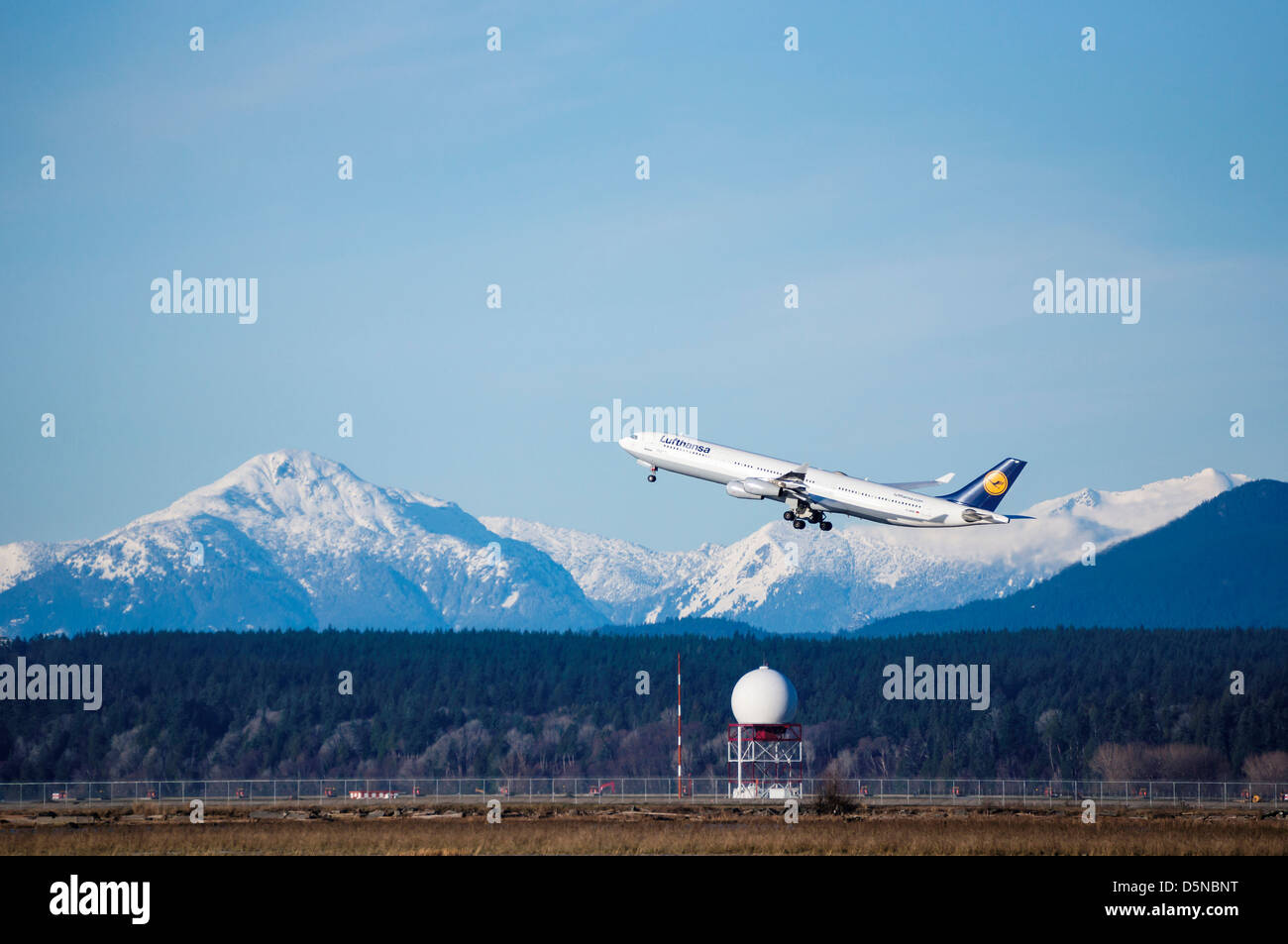 Lufthansa aircraft is taking off in Vancouver International Airport. - Stock Image