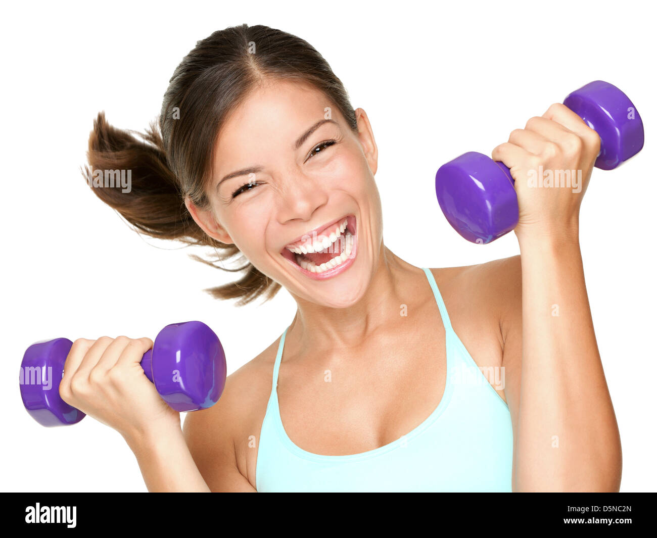 Portrait of happy young mixed race Asian Caucasian fitness woman lifting dumbbells isolated on white background - Stock Image