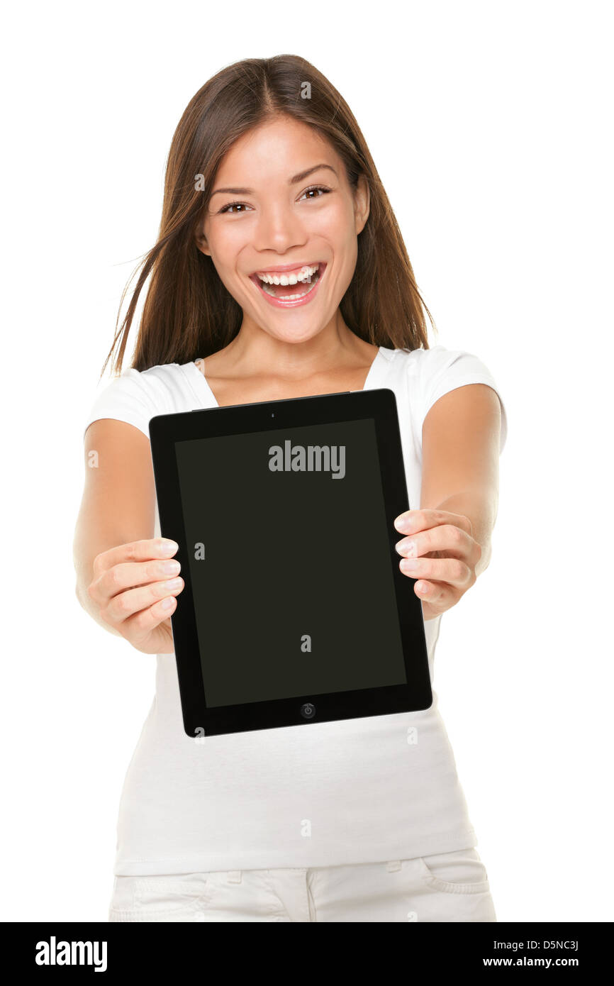 Portrait of happy mixed race Caucasian Asian young woman showing touchpad screen of tablet PC isolated on white - Stock Image