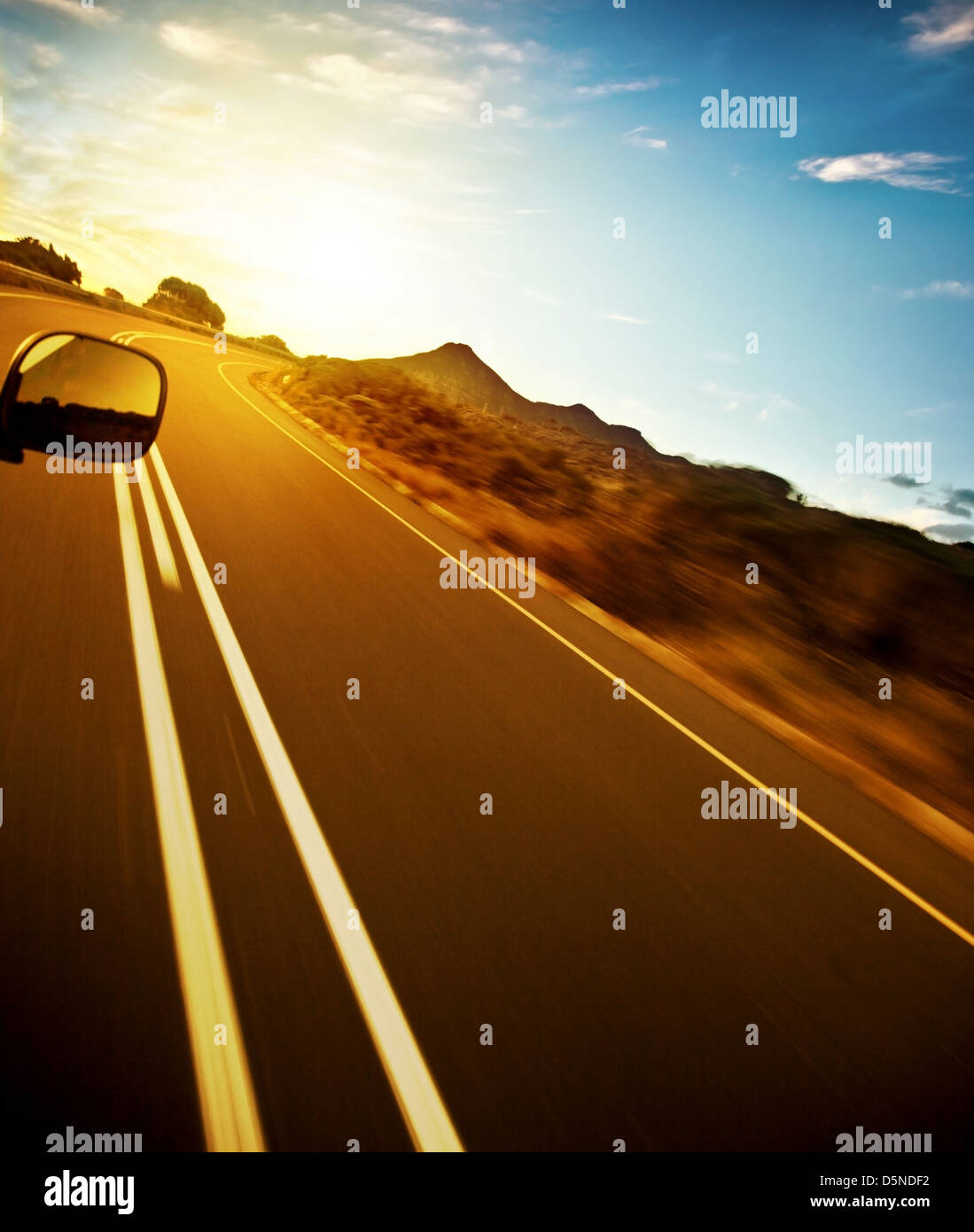 Road trip, car on the highway, speed drive, road-trip in sunny day, journey and freedom concept, travel and vacation - Stock Image