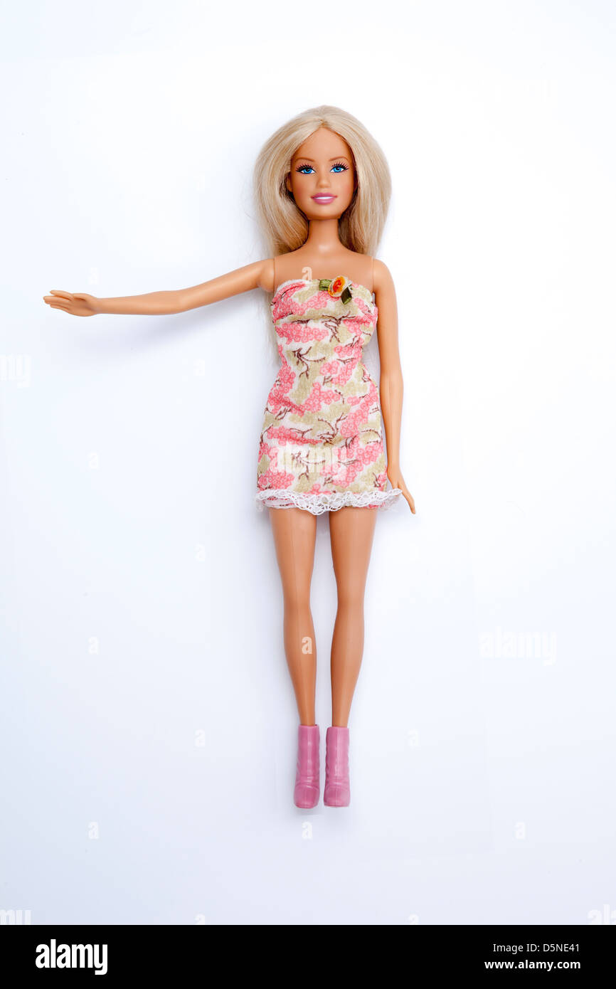 Barbie doll, arm raised. Isolated on a white background. - Stock Image