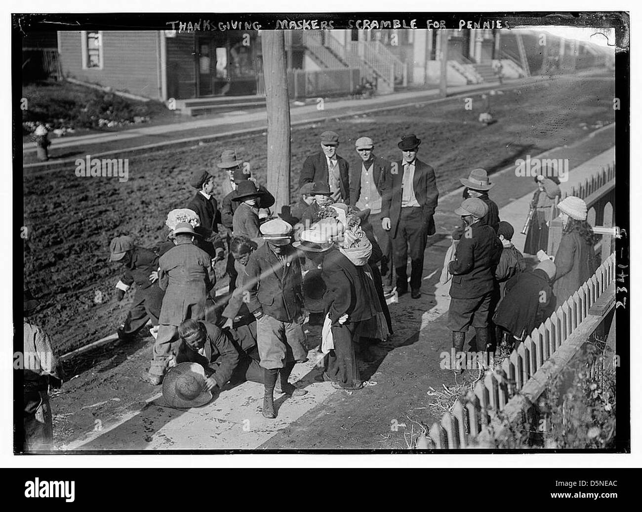 Thanksgiving Maskers scramble for pennies (LOC) - Stock Image