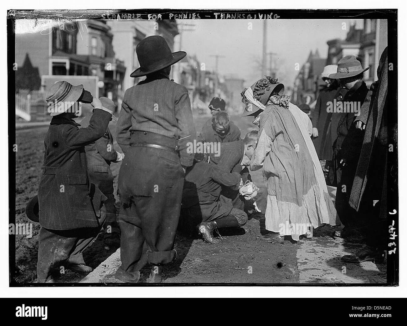 Scramble for pennies, Thanksgiving (LOC) - Stock Image