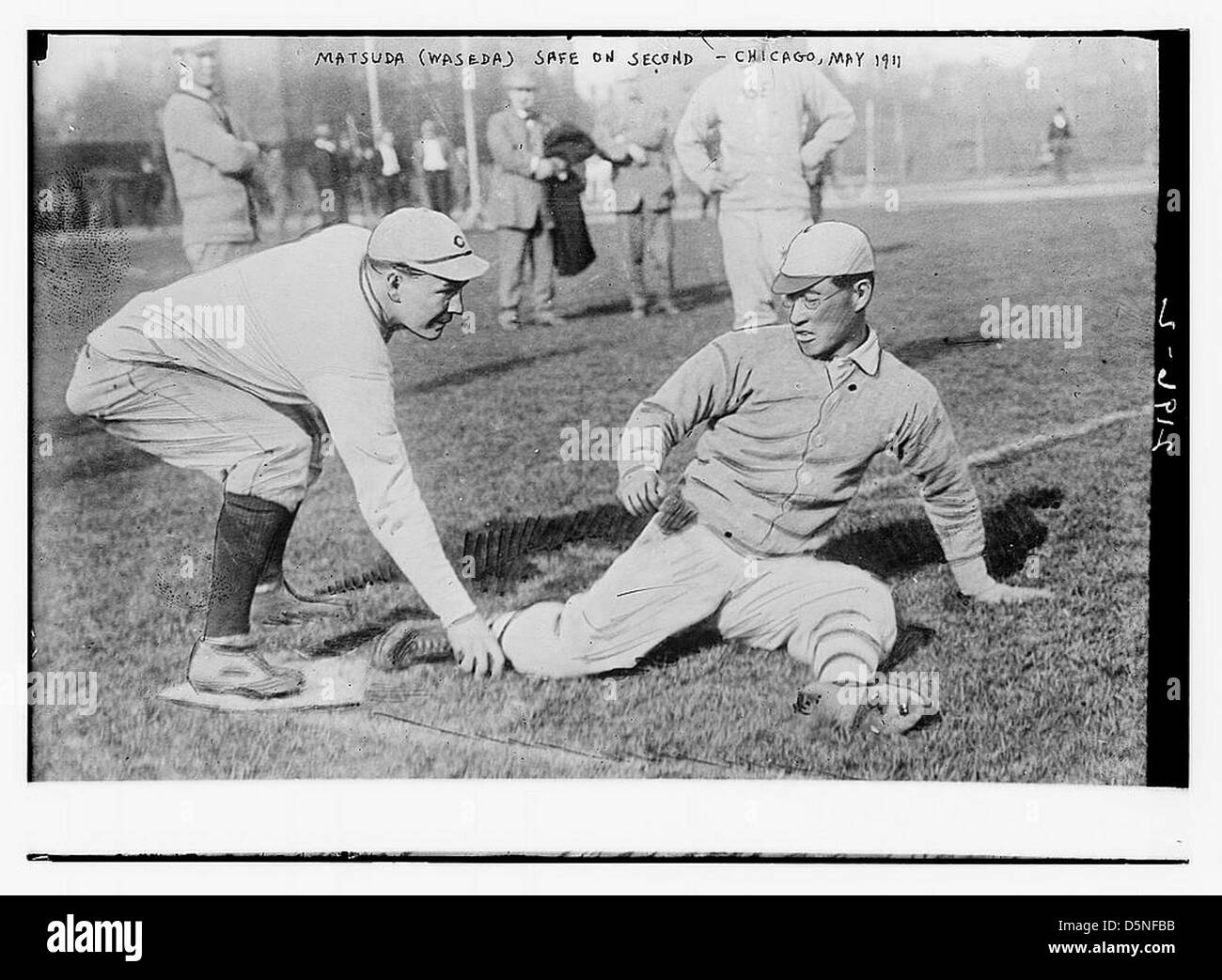 [Matsuda (Waseda University, Japan) is safe; a re-enactment of a play from a baseball game with Chicago University, - Stock Image