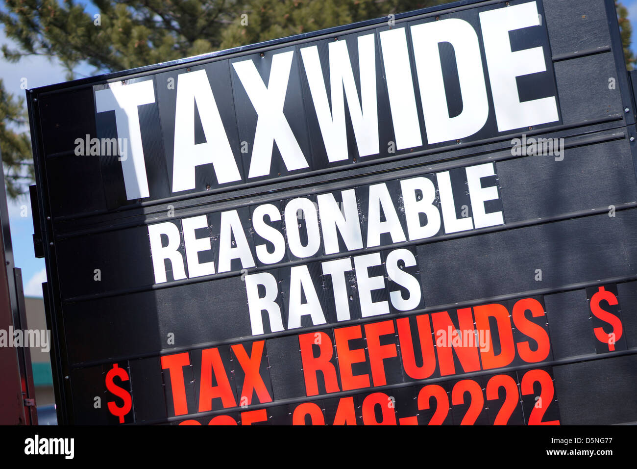 Tax Preparation Advertisement, Income Tax Return Filing - Stock Image