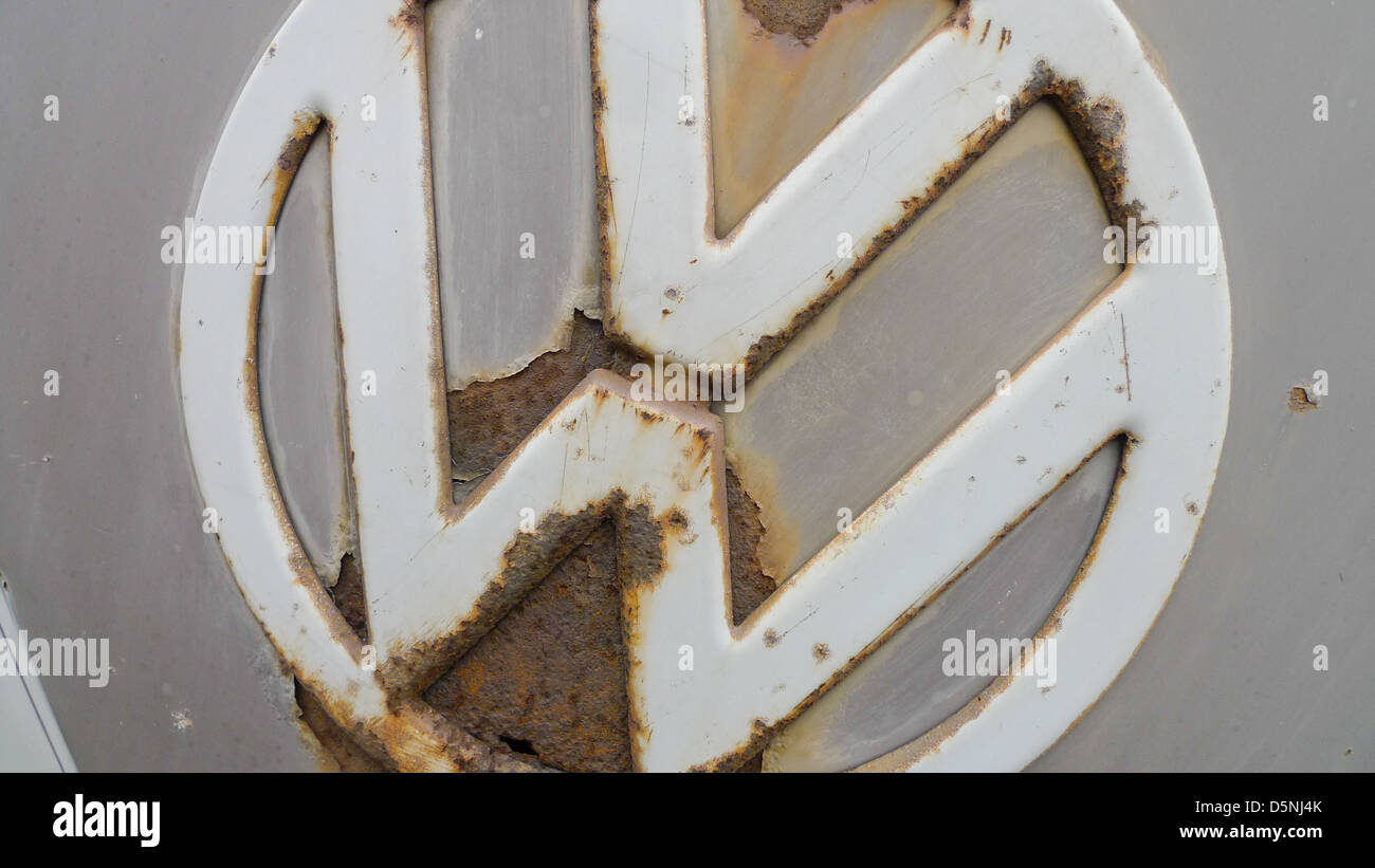 A VW badge on an old Volkswagen van. - Stock Image