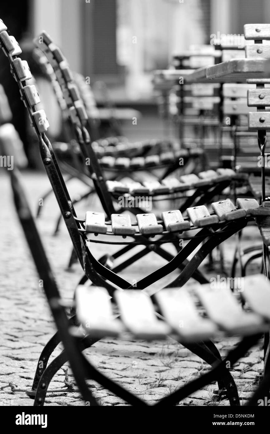 Empty chairs in beer garden in the Rheingau, Hesse, Germany - Stock Image
