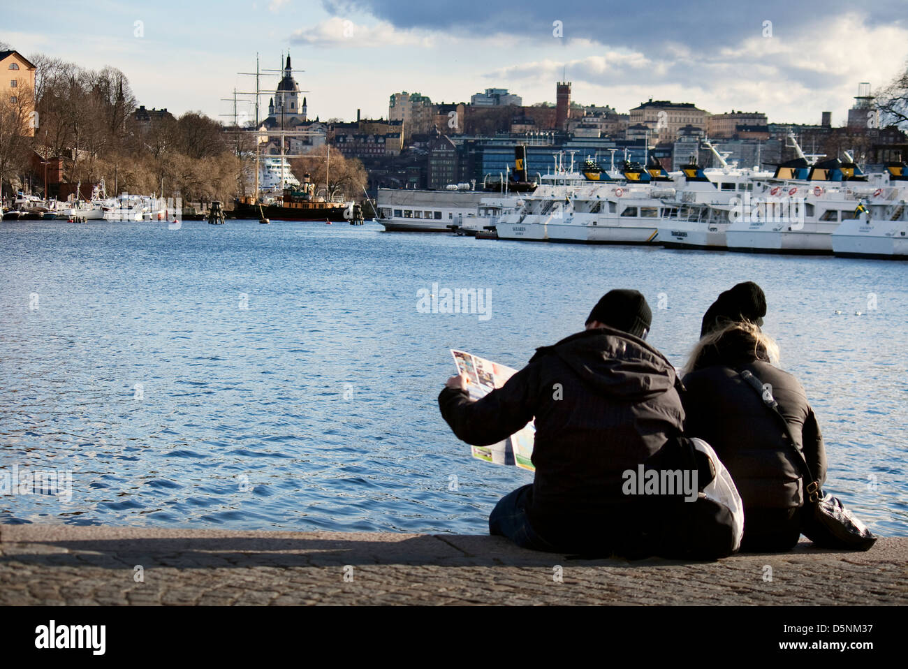 Scandinavia; Sweden; Swedish; Stockholm; Baltic; Sea; Ships; Ship; Harbour; People; Couple; Reading; Sitting; Relax; - Stock Image