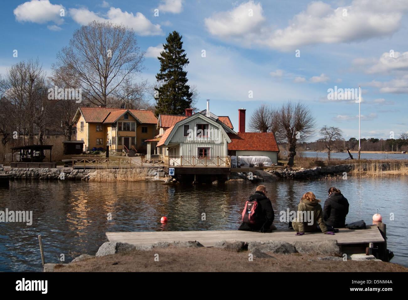 Scandinavia Sweden Swedish Stockholm Baltic Sea Island Archipelago Vaxholm Wood House Typical Boat Dock Peple: Sitting - Stock Image