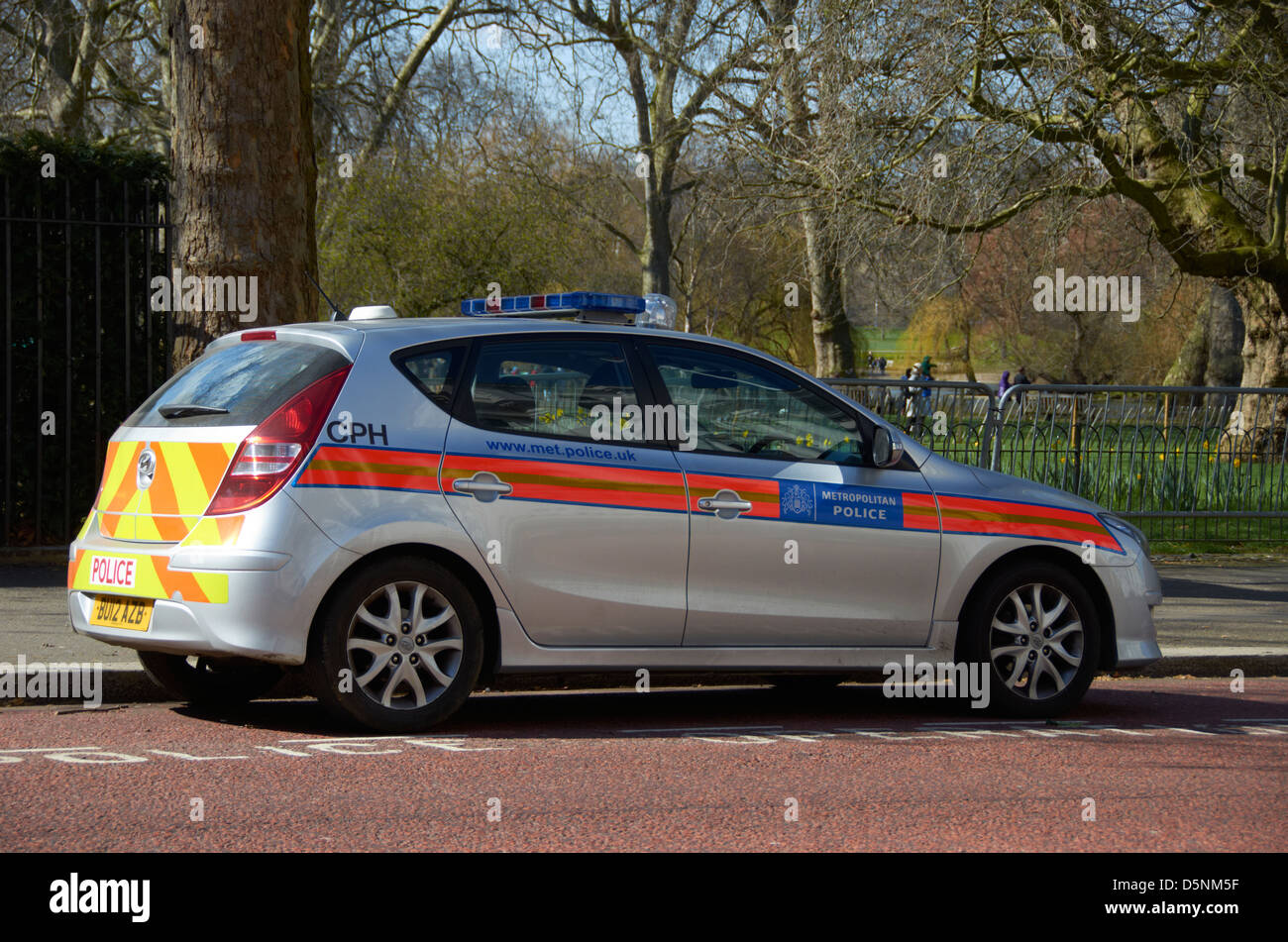 Silver police car parked on Horse Guards Road, London (next to St James Park). - Stock Image